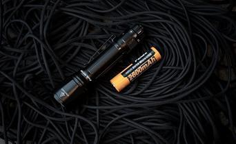 How do you maintain a flashlight?